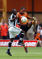 Fotball. 2002/2003. 03.08.2002.<br /> Wolverhampton v Newcastle.<br /> Joleon Lescott, Wolves.<br /> Lomana Lua Lua, Newcastle.<br /> Foto: Tim Parker, Digitalsport