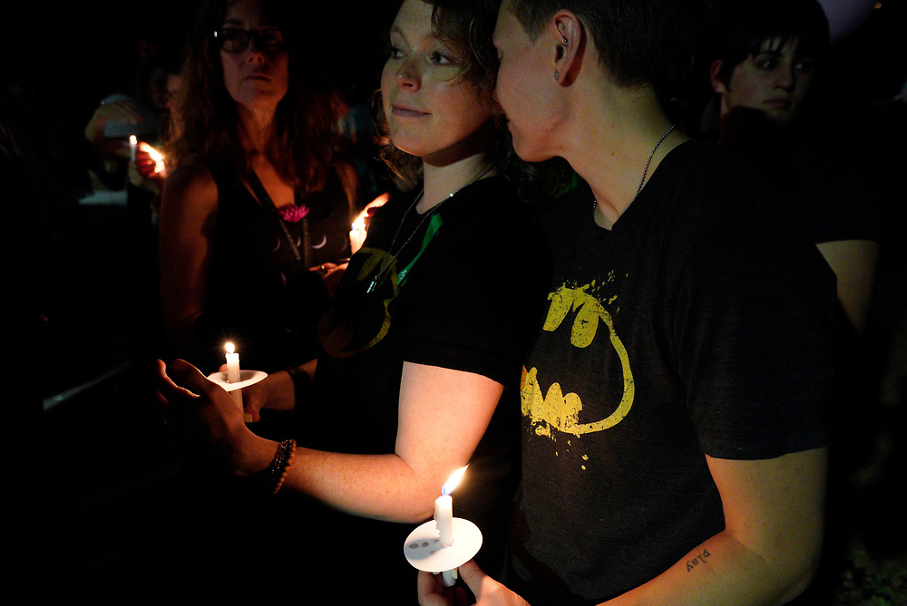 People wearing Batman shirts hold candles at a vigil for the Aurora theater shooting on the 5-year anniversary of the tragedy in Aurora, Colorado United States July 20, 2017.  REUTERS/Rick Wilking