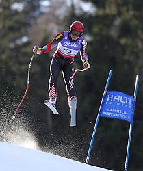 10.02.2011, Kandahar, Garmisch Partenkirchen, GER, FIS Alpin Ski WM 2011, GAP, Herren Abfahrtstraining, im Bild Tin Siroki (CRO) takes to the air competing in the first men's downhill training run on the Kandahar race piste at the 2011 Alpine skiing World Championships, EXPA Pictures © 2011, PhotoCredit: EXPA/ M. Gunn