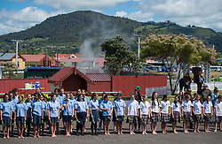 Schoolchildren line up to see the arrival of the Duke and Duchess of Sussex during a visit to Te Papaiouru, Ohinemutu, in Rotorua, before a lunch in honour of Harry and Meghan, on day four of the royal couple's tour of New Zealand.
