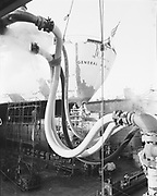 ackroyd-P474-01  February 13, 1969 U. S. Naval ship General H. H. Arnold at Swan Island Drydock #3. ship repair, sandblasting.
