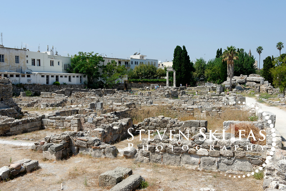 Kos Town. View across building ruins to restored columns from the Agora in the eastern Archeological zone. The Agora was one of the largest in the ancient world. Kos is part of the Dodecanese island group and birthplace of the ancient physician and father of medicine, Hippocrates.