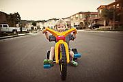 Boy Riding A Big Wheel
