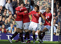 Fotball<br /> England 2005/2006<br /> Foto: Colorsport/Digitalsport<br /> NORWAY ONLY<br /> <br /> Ruud Van Nistelrooy (Utd) celebrates his 2nd goal with Wayne Rooney, Ji Sung Park and Rio Ferdinand - Fulham v Manchester United. 1/10/2005