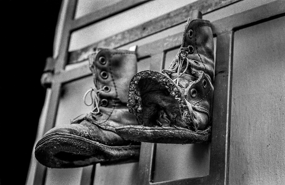 Army boots hanging in a doorway, Sarajevo