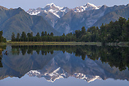 Oceania; New Zealand; Aotearoa; South Island; West Coast,  South Westland, Lake Mathesonnear the Fox Glacier with view to Mount Cook and Mount Tasman