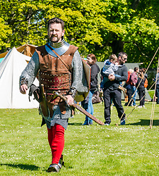 Medieval Day. Dirleton Castle, East Lothian, Scotland, United Kingdom, 11 May 2019. Pictured:  Historic Environment Scotland family fun day at the Living Medieval Village by Saltire History Society in the castle gardens. Andrew Spratt, custodian at the castle dressed as Robert the Bruce, King of Scots.<br /> <br /> Sally Anderson   EdinburghElitemedia.co.uk