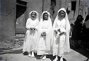 three girls posing on there holy communion day France