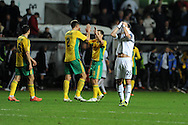 Swansea city 's Alvaro Vazquez shows his frustration as Kuban Krasnodar players celebrate after drawing match 1-1.  UEFA Europa league match, Swansea city v FC Kuban Krasnodar at the Liberty Stadium in Swansea, South Wales on Thursday 24th October 2013. pic by Andrew Orchard, Andrew Orchard sports photography,
