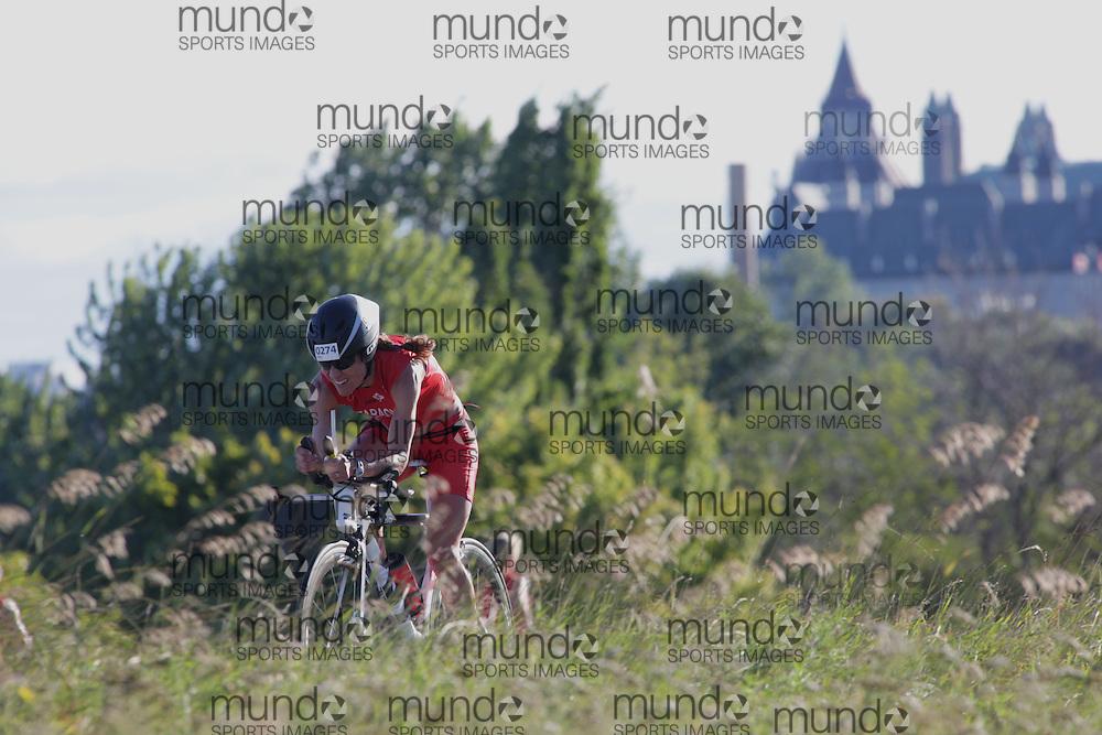 (Ottawa, Canada---10 August 2013)  Jennifer Faraone (274)  of Canada (CAN) competing in the 35-39 Female AG International Triathlon Union 2013 World Duathlon Championships (10 km run- 40 km bike- 5km run).