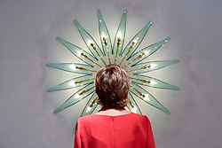 """© Licensed to London News Pictures. 28/06/2017. London, UK.  A woman views a """"Dahlia"""" chandelier by Max Ingrand.  Preview day at Masterpiece London, a leading art fair held in Chelsea, bringing together 150 international exhibitors presenting works from antiquity to the present day.  The event runs 29 June to 5 July 2017.   Photo credit : Stephen Chung/LNP"""