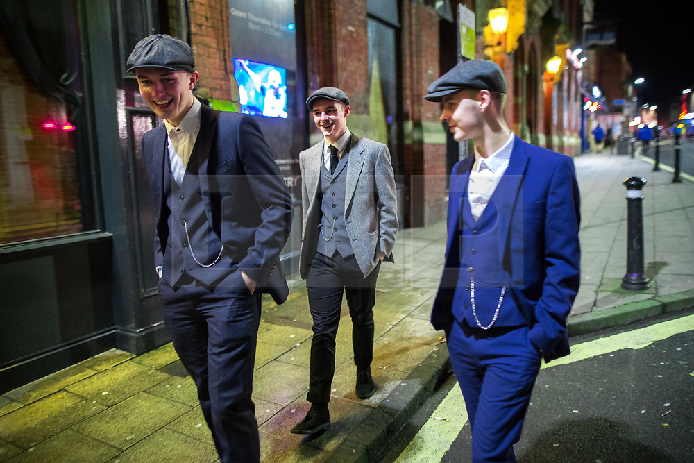 © Licensed to London News Pictures . 26/12/2017. Wigan, UK. Peaky Blinders . Revellers in Wigan enjoy Boxing Day drinks and clubbing in Wigan Wallgate . In recent years a tradition has been established in which people go out wearing fancy-dress costumes on Boxing Day night . Photo credit: Joel Goodman/LNP
