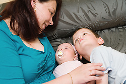 Polish mother looking at her children with affection,
