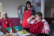 A Sunday community lunch with helpers at Linton Lane Community Centre, Kirkcaldy, Fife. For many this might be one of the few hot meals they get served outside of their home, each week.<br /><br />Kirkcaldy is one of the poorest areas in Scotland with staggeringly high numbers of child poverty. Many disadvantaged families, and vulnerable people, and over a thousand children are surviving below the breadline in Kirkaldy East, that is 40%. Voluntary organisations and foodbanks give over a thousand food parcels a month, several times more than a few years ago. The Conservative government's policy of austerity together with the new 'Universal Credit' system which replaced six other benefits, makes millions of people poorer, many hundreds of thousands on the poverty line or below. Whilst people overall voted strongly against Brexit in Scotland, in other parts of the country, poorer constituencies voted largely for Brexit, in a vote against the City of London.
