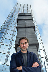 "© Licensed to London News Pictures. 05/11/2019. LONDON, UK. Artist Idris Khan at the preview of his ""65,000 Photographs"", an aluminium and steel structure 8m tall, rising skywards in constituent blocks growing in size in relation to dimensions of standard photographic prints.  Unveiled at One Blackfriars, the artwork was commissioned by London Borough of Southwark as part of the One Blackfriars Public Art programme.  Photo credit: Stephen Chung/LNP"