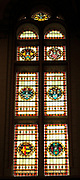 Stained glass window at the Rijksmuseum, Amsterdam, Holland. Depicts various heraldic shields and emblems