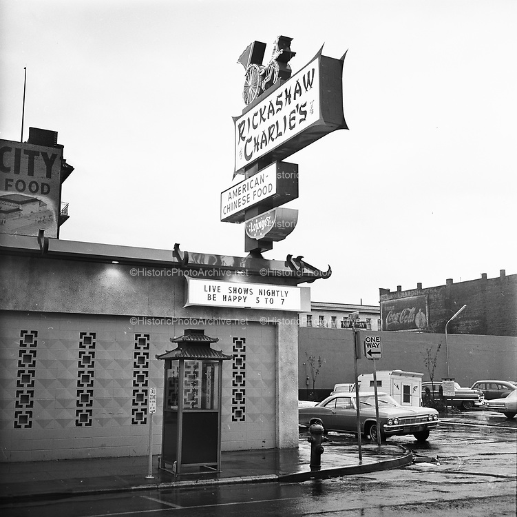 Y-661116B-10. Pacific NW Bell. Rickashaw (Rickshaw) Charlie's, NW 5th & Davis, Chinese telephones. November 16, 1966