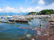Trash collecting along the shore of busy port, Puerto Princesa, Palawan, Philippines, Southeast Asia