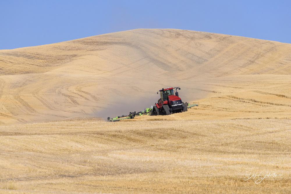 Tractor working the land, near Pullman, Washington, USA