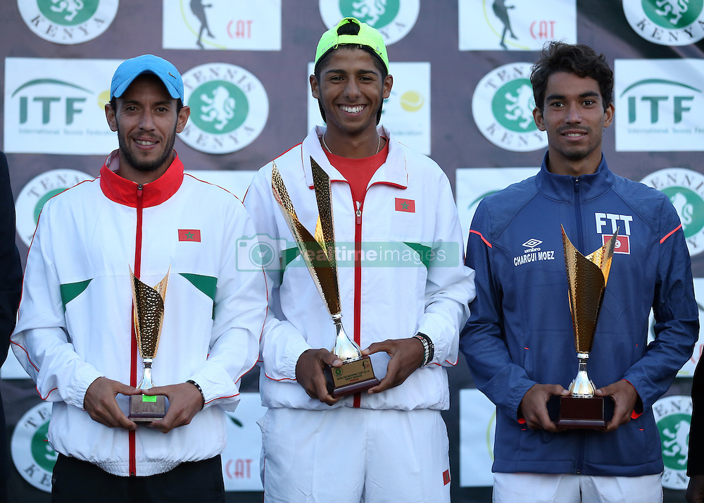 Amine Ahouda (C) from Morocco celebrates wining the mens singles with Yassine Idmbarek (L) of Morocco 3rd position, and Moez Echanrgui (R) securing 2nd position during their 14th African Nations Cup (CAN) 2016 on the Final day at Nairobi Club on November 13, 2016. Photo/Fredrick Onyango/www.pic-centre.com (KEN)