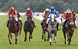 Love Island's Chris Hughes (2nd left) rides Carnageo during The Best Western Hotels & Macmillan Ride of their Lives, during the Macmillan Charity Raceday at York Racecourse.