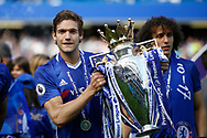 Chelsea Defender Marcos Alonso (3) celebrates with the trophy during the Premier League match between Chelsea and Sunderland at Stamford Bridge, London, England on 21 May 2017. Photo by Andy Walter.