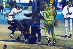 © Licensed to London News Pictures . 07/04/2017 . Manchester , UK . 5th in a sequence . Five youths on one as a fight breaks out in which a man's head is kicked and stamped upon , in Piccadilly Gardens . Greater Manchester Police have authorised dispersal powers and say they will ban people from the city centre for 48 hours , this evening (7th April 2017) , in order to tackle alcohol and spice abuse . Photo credit : Joel Goodman/LNP