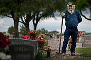 WEST, TEXAS - APRIL 17:  Jake Sulak poses for a portrait after digging a grave at the St Mary's Catholic Cemetery in West, Texas on April 17, 2017. (Photo by Cooper Neill for The Washington Post)