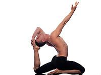 Man yoga Eka Pada Rajakapotasana pose One-Legged King Pigeon stretch gymnastic acrobatics  studio on white background