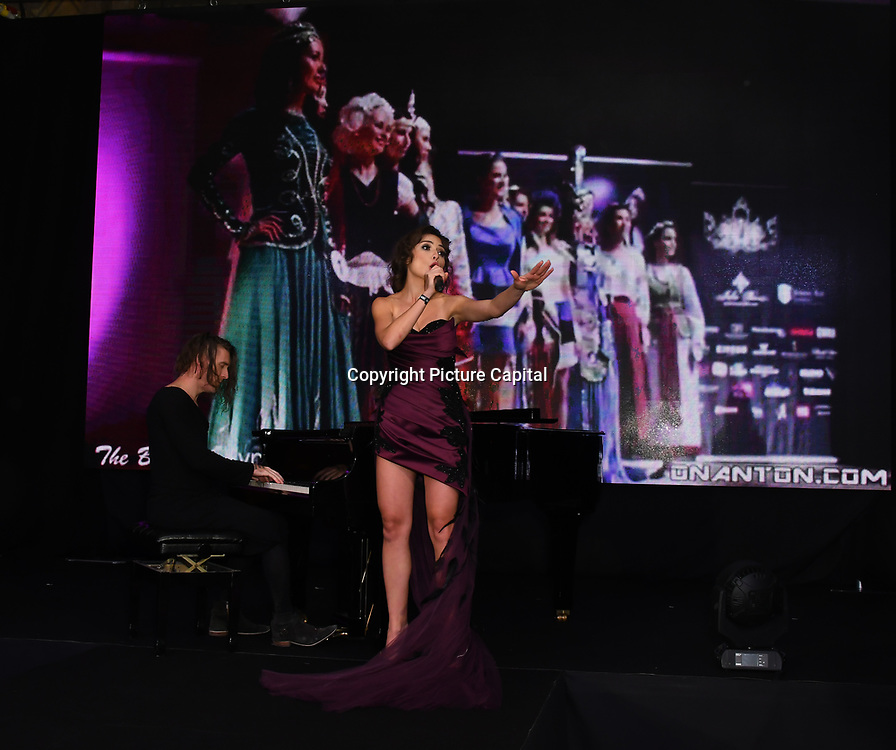 X-Factor, UK Star, Irina Dedyuk and pianist ,Dave Yaden performs at the Grand Final MISS USSR UK 2019 at Hilton hotel London on 27 April 2019, London, UK.