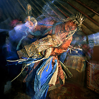 Umgan, a traditional shaman beats his drum, dances and chants to put himself into a trance in the Darhad Valley, Mongolia.