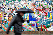 A pedestrian walks by a mural celebrating Harlem's rich musical culture, located on Frederick Douglass Blvd in Harlem.   Harlem, a neighborhood of New York City in Manhattan, began as a Dutch village in 1658 and was later annexed to New York City in 1873.  At the beginning of the 20th century African-American's began arriving from the southern American states looking for work in the more industrious north.  With their migration, the African-American community brought with them a renaissance in the arts to Harlem that is still evident today.  After World War II Harlem began experiencing a significant rise in crime and poverty due to the Great Depression that lasted until the 21st century.  A new pride in the community has brought a renewed revival to Harlem, and crime rates have dropped to record lows giving the New York City neighborhood a new lease on life.