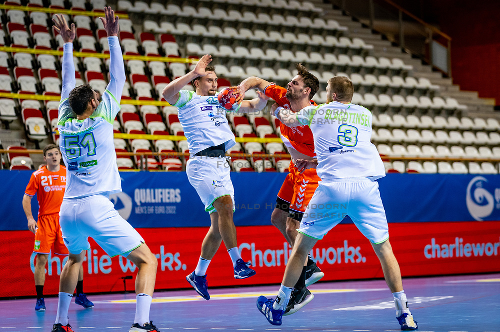 The Dutch handball player Jorn Smits in action against Darko Cingesar, Blaz Blagotinsek from Slovenia during the European Championship qualifying match on January 6, 2020 in Topsportcentrum Almere