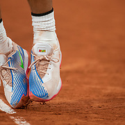 PARIS, FRANCE September 28. The tennis shoes of Rafael Nadal of Spain as he serves against Egor Gerasimov of Belarus in the first round of the singles on Court Philippe-Chatrier competition during the  French Open Tennis Tournament at Roland Garros on September 28th 2020 in Paris, France. (Photo by Tim Clayton/Corbis via Getty Images)