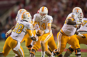 Nov 12, 2011; Fayetteville, AR, USA;  Tennessee Volunteers quarterback Justin Worley (14) hands the ball off to tailback Tauren Poole (28) as offensive linemen Marcus Jackson (68) looks for the block during a game against the Arkansas Razorbacks at Donald W. Reynolds Razorback Stadium. Arkansas defeated Tennessee 49-7. Mandatory Credit: Beth Hall-US PRESSWIRE