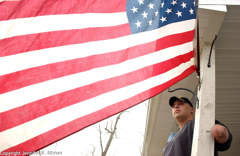 ARMOR03 Robert Loria, age 27, who was in Bravo Company, 588th Engineer Battalion attached to the Fourth Infantry Division, and was wounded last year by a roadside bomb in Baqubah, Iraq, causing him to lose his left arm and severely injuring the left side of his body, is seen at his home in Montgomery, NY. <br /> His wife Christine did not want to be in any photographs. 3/30/2005 Photo by Jennifer S. Altman