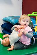 Nederland, Veghel, 20101117.?Kind op de creche. Ze speelt met een pop.?Kinderopvang 't Kroontje in Veghel...Netherlands, Veghel, 20101117. ?Child at the nursery. She is playing with a doll..Childcare t Kroontje in Veghel..
