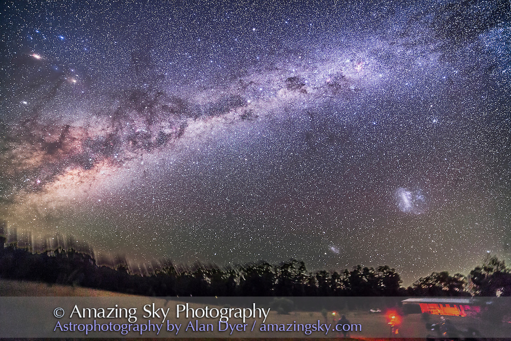 The sweep of the southern Milky Way from Vela at far right, to Sagittarius at far left, over the grounds of the Warrumbungles Motel, near Coonabarabran, NSW, Australia at the 2016 OzSky Star Party. Some astrophotographers are in the foreground. Most of teh southern sky's finest sights are in this view: The Southern Cross and Carina Nebula are at upper centre. Scorpius, with bright Mars and Saturn, is at far left. Mars is the brightest object at upper left. The Magellanic Clouds are at lower right, setting. <br /> <br /> This is a stack of 5 x 3 minute exposures all at f/2.8 with the 14mm Rokinon lens and filter-modified Canon 5D MkII at ISO 2000. The foreground comes from just one of the exposures to minimize trailing. All shots were taken with the camera on the iOptron Sky Tracker.