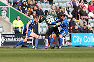Paul Robinson defender for AFC Wimbledon (6) and Dannie Bulman midfielder of AFC Wimbledon (4) close down Plymouth Argyle midfielder Hiram Boateng (20) during the Sky Bet League 2 match between Plymouth Argyle and AFC Wimbledon at Home Park, Plymouth, England on 9 April 2016. Photo by Stuart Butcher.