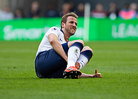 Football - 2018 / 2019 Premier League - Tottenham Hotspur vs. Arsenal<br /> <br /> Harry Kane (Tottenham FC)  lies on the ground after being tackled at Wembley Stadium.<br /> <br /> COLORSPORT/DANIEL BEARHAM
