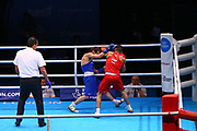 Galal Yafai of Great Britain (red) and Rasul Saliev of Russia (bue) competing in the Men's Featherweight preliminaries during The Road to Tokyo European Olympic Boxing Qualification, Sunday, March 15, 2020, in London, United Kingdom. (Mitchell Gunn-ESPA-Images/Image of Sport)