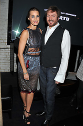 SIMON & YASMIN LE BON at a party to celebrate the launch of the new Vertu Constellation phone - the luxury phonemakers first touchscreen handset, held at the Farmiloe Building, St.John Street, Clarkenwell, London on 24th November 2011.