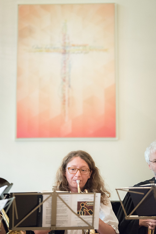 """1 July 2018, Geneva, Switzerland: Annegret Kapp plays the trumpet. On Sunday, LWF Council members joined local congregants for Sunday service at the Evangelical Lutheran Church in Geneva. The 2018 LWF Council meeting takes place in Geneva from 27 June - 2 July. The theme of the Council  is """"Freely you have received, freely give"""" (Matthew 10:8, NIV). The LWF Council meets yearly and is the highest authority of the LWF between assemblies. It consists of the President, the Chairperson of the Finance Committee, and 48 members from LWF member churches in seven regions."""