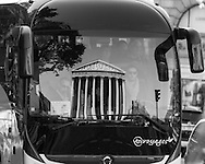 Paris, The Madeleine church , reflected on a bus.