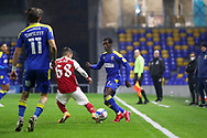 AFC Wimbledon defender Paul Osew (37) passing to AFC Wimbledon midfielder Ethan Chislett (11) during the EFL Trophy match between AFC Wimbledon and U21 Arsenal at Plough Lane, London, United Kingdom on 8 December 2020.