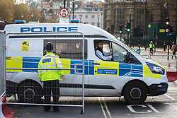 London, UK. 12th November, 2020. Metropolitan Police officers transport to Charing Cross police station one of three Action for Climate Truth and Reparations (ACTR) activists arrested after having taken part in an action to hang an open letter to the UK people from Africans Rising For Justice, Peace and Dignity from the Houses of Parliament. The letter, which launches Africans Rising's ReRight History campaign, contains a plea to the UK people to start making amends for the harm caused by slavery and colonialism.