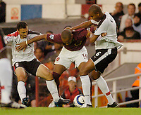 Photo: Leigh Quinnell.<br /> Arsenal v Fulham. The Barclays Premiership.<br /> 24/08/2005. Arsenals Thierry Henry is tackled by Fulhams Steed Malbranque and Zat Knight.