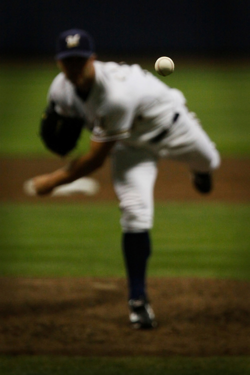 Chris Capuano of the Milwaukee Brewers pitches the ball in a game against the Cincinnati Reds at Miller Park July 28, 2010.