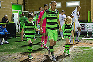 Forest Green Rovers Liam Noble(15) leads the team out during the Vanarama National League match between Forest Green Rovers and Tranmere Rovers at the New Lawn, Forest Green, United Kingdom on 22 November 2016. Photo by Shane Healey.