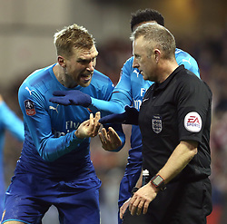 07 January 2018 FA Cup 3rd round Nottingham - Nottingham Forest v Arsenal - Per Mertesacker of Arsenal confronts referee Jonathan Moss after the second penalty for Forest .<br /> (photo by Mark Leech)